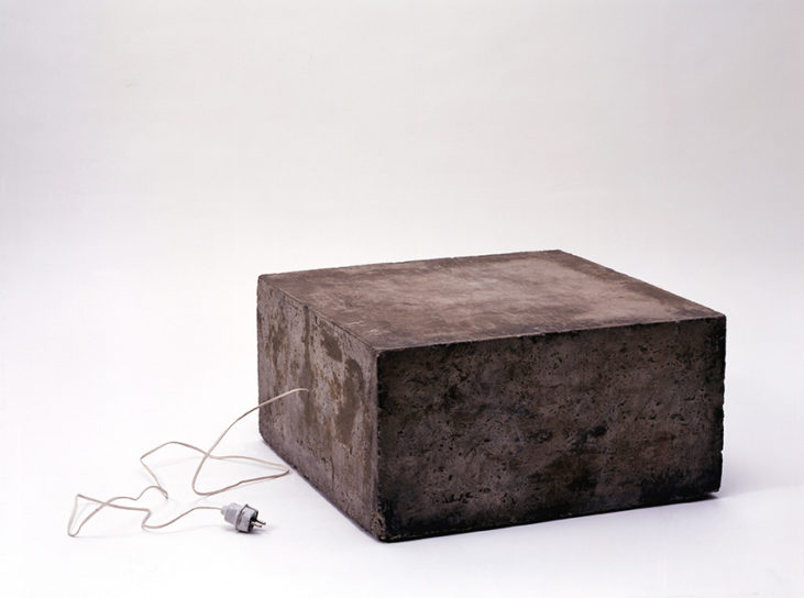 Tape recorder with tape loop of a scream wrapped in a plastic bag and cast into the center of a concrete block